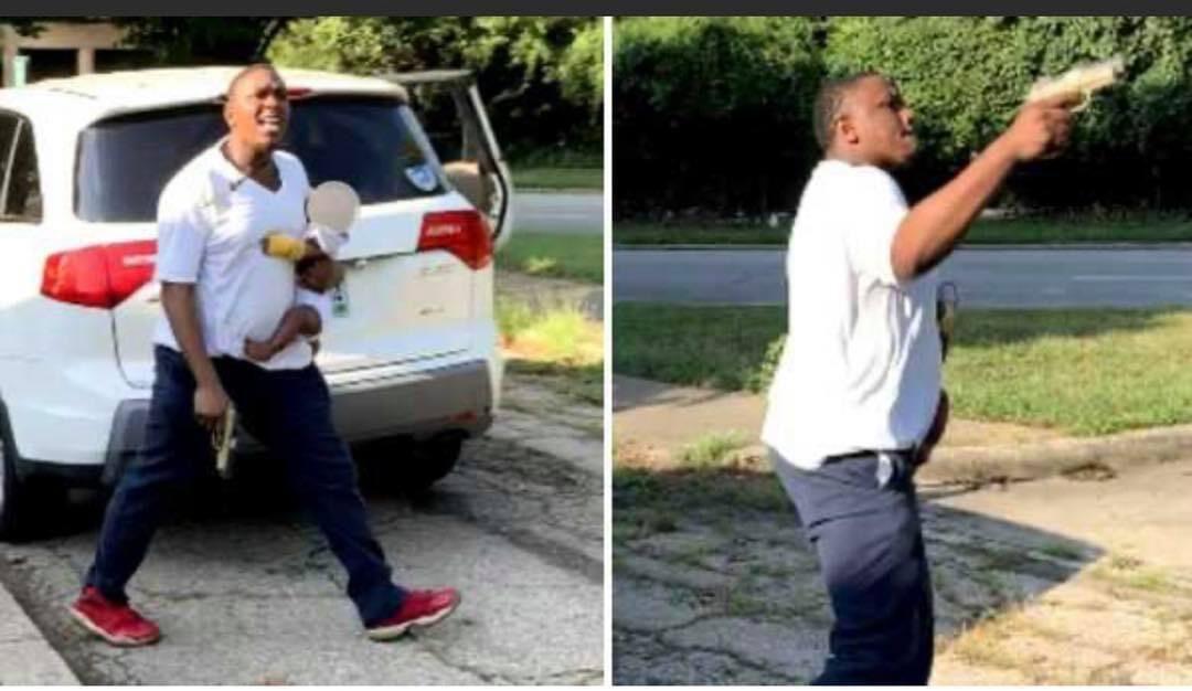 MAN FIRES GUNSHOTS WHILE HOLDING A BABY